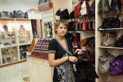 Woman in handbags store Royalty Free Stock Photo