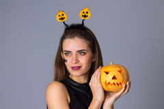 Woman with handband holding a pumpkin Stock Image