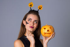 Woman with handband holding a pumpkin Stock Images