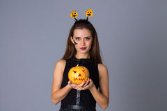Woman with handband holding a pumpkin Stock Photo
