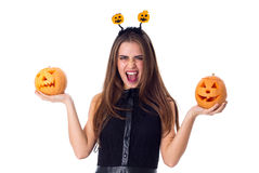 Woman with handband holding two pumpkins Royalty Free Stock Photo