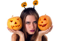 Woman with handband holding two pumpkins Royalty Free Stock Photos