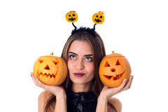 Woman with handband holding two pumpkins Royalty Free Stock Image
