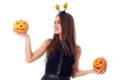 Woman with handband holding two pumpkins Royalty Free Stock Photography