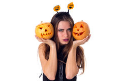Woman with handband holding two pumpkins Stock Photography