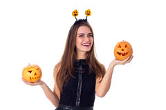 Woman with handband holding two pumpkins Stock Images