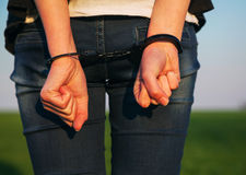 Woman with handcuffed hands Royalty Free Stock Photos