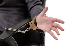 Woman handcuffed to a chair Stock Photography