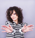 Woman with handcuffs. Beautiful young woman with handcuffs, studio shot royalty free stock photography