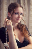 Woman with handcuffs. Beautiful woman plays with handcuffs Stock Photos