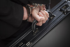Woman In Handcuffs Carrying Briefcase Royalty Free Stock Photography