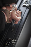 Woman In Handcuffs Carrying Briefcase Royalty Free Stock Image