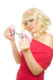 Woman with handcuffs (focus on handcuffs) Stock Photography