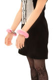 Woman with handcuffs on her hand Royalty Free Stock Photography