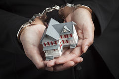Woman In Handcuffs Holding Small House Stock Image