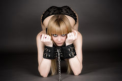 Woman in handcuffs kneeling Royalty Free Stock Photography