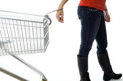 Woman with handcuffs pinned to shopping cart Stock Images