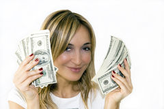 Woman with handful of money Stock Photos