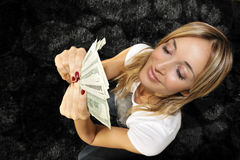 Woman with handful of money Royalty Free Stock Photos