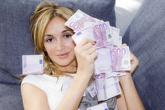 Woman with handful of money Stock Images