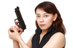 Woman with a handgun Royalty Free Stock Photography