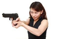 Woman with a handgun Stock Image