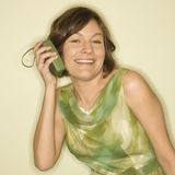 Woman with handheld radio. Stock Photography