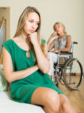 Woman and handicapped female having quarrel Stock Image