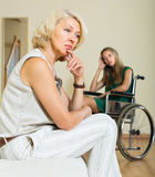 Woman and handicapped female having quarrel Royalty Free Stock Image