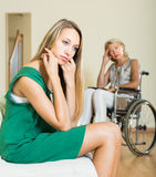 Woman and handicapped female having quarrel Royalty Free Stock Photography