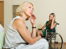 Woman and handicapped female having quarrel Royalty Free Stock Photo
