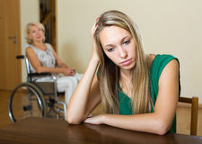 Woman and handicapped female having quarrel Stock Photos