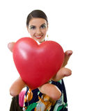 Woman handing a big red heart Stock Images