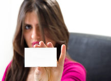 Woman handing a blank business card. Beautiful Woman with Blank Business Card Isolated on White Royalty Free Stock Image