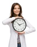 Woman handing clock Stock Images