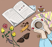 Woman handing cup in cafe. Book, candies and roses on the table Royalty Free Stock Photo