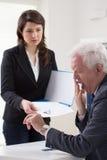 Woman handing CV Royalty Free Stock Image