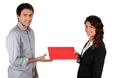 Woman handing folder to man royalty free stock photos
