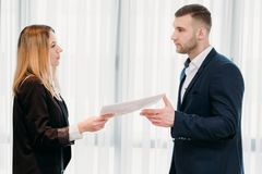 Letter resignation boss business career job quit. Woman handing her letter of resignation to a strict boss. business career change. job quitting. voluntary royalty free stock photography
