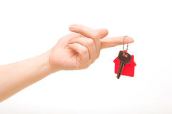 Woman is handing a house key Stock Photo