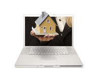 Woman Handing House Through Laptop Screen Stock Image