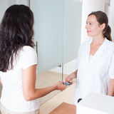 Woman handing in the insurance card Stock Image