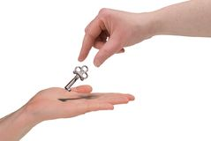 Woman handing key Stock Photo
