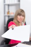 Woman is handing over a document Royalty Free Stock Photography