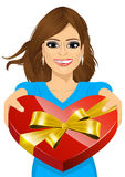 Woman handing over a heart shaped box stock illustration
