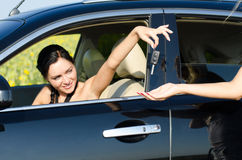 Woman handing over her car keys Royalty Free Stock Photography