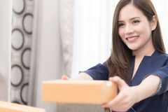 Woman handing package box for mailing and shipment. Woman is handing package box for mailing and shipment Royalty Free Stock Images