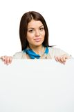 Woman handing sheet of paper copyspace Royalty Free Stock Image