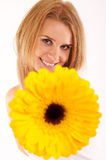 Woman is handing you a flower Stock Image