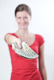 Woman handing you money Royalty Free Stock Image